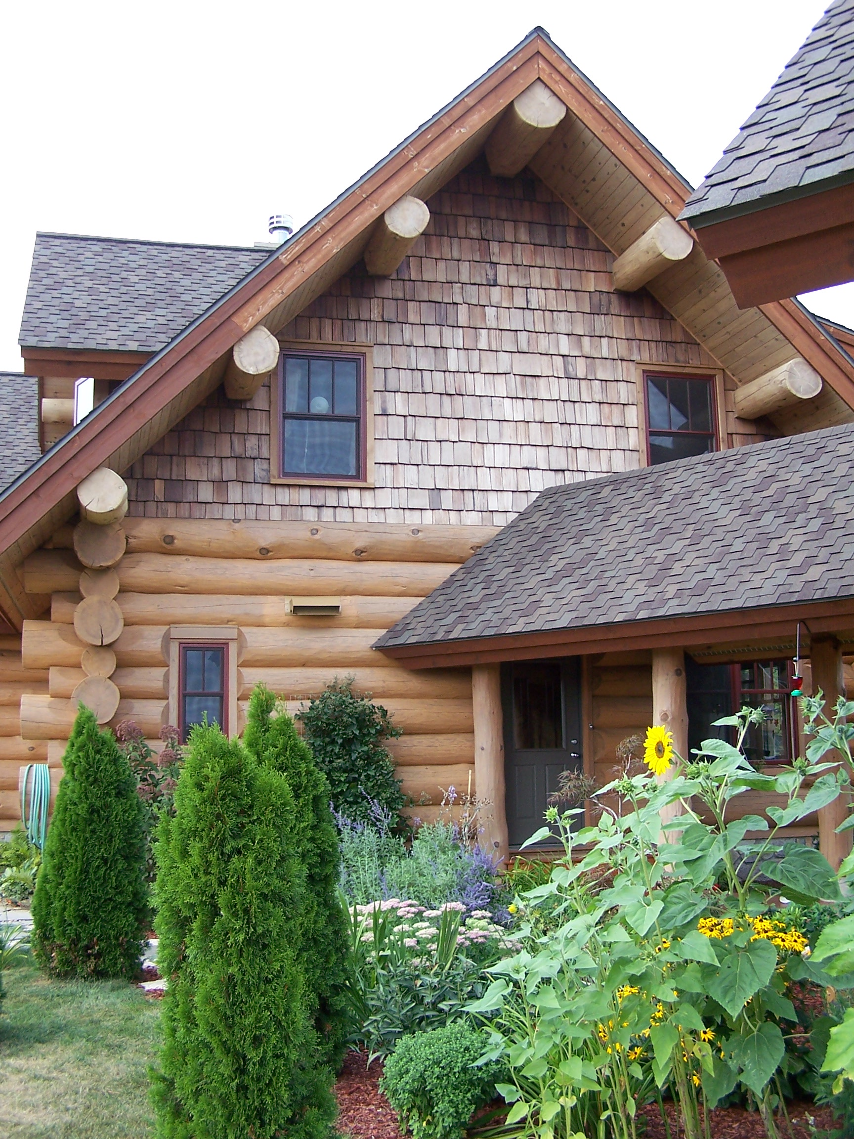 Custom handcrafted log homes gallery timber wolf for Log construction